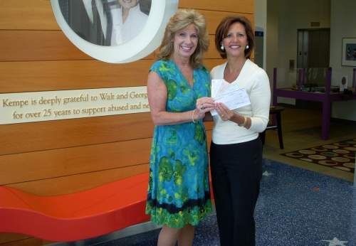 Terri Fisher presents donation checks to Pat Peterson
