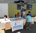 Dr. Karen Frankel talks to kids and parents about Kempe and Fussy Baby Network Colorado at the kids coloring station.
