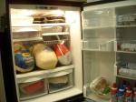 Thanksgiving turkeys and pies in fridge